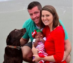 white husband white wife black baby concerned dog